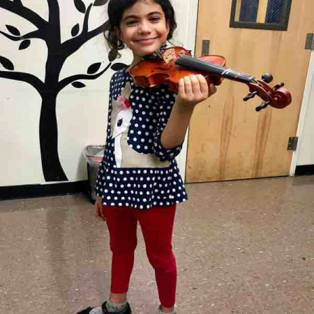 Student showing off her beautiful violin posture!