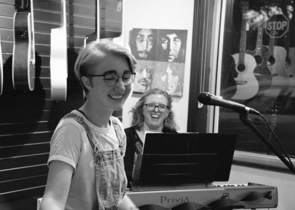 Laughing with my voice student Madison at an open mic performance!