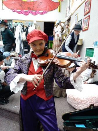 """Student as the fiddler in their school production of """"Fiddler on the Roof""""."""