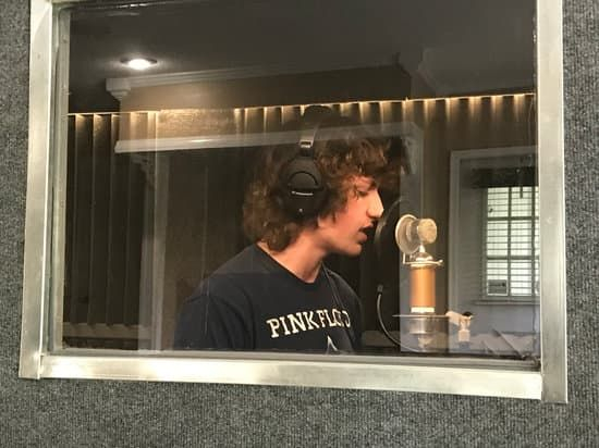 Gavin in the vocal booth recording a song through one of our MVA programs.