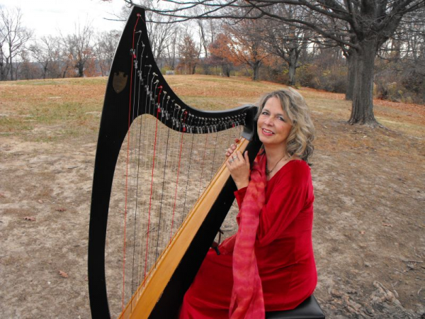 """Performing in the park.  This Troubadour is a """"grand old lady"""" from 1960, sounds wonderful with gut strings."""