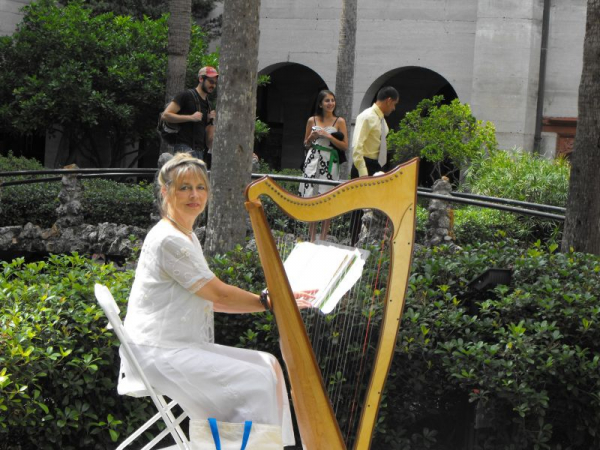 Playing the Scottish wedding at Lightner Museum courtyard, St. Augustine, FL.  That harp is so light it tips over easily!