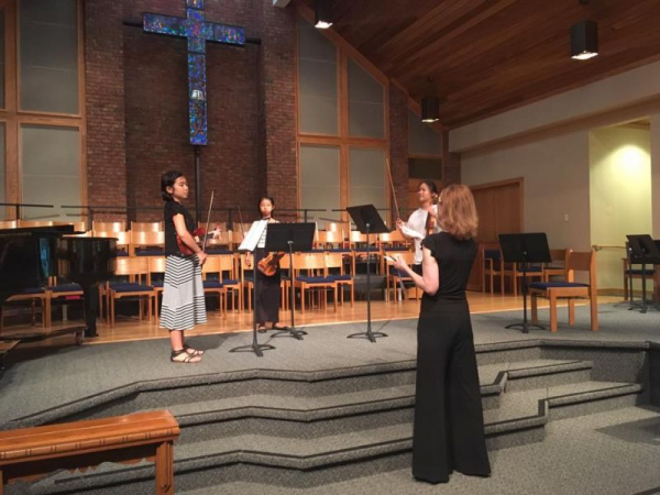 Adding the final touches for a student ensemble during a dress rehearsal for the PYCO Chamber Music Seminar concert (Pittsburgh, PA).