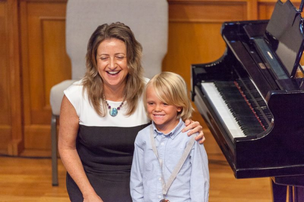Lisa with piano student at recital.  I encourage students to share their talent.