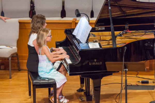 Me playing a duet with a student.