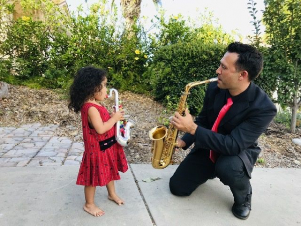 I love how my daughter emulates me on her plastic toy sax.