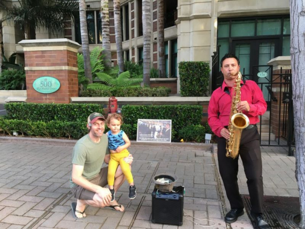 I was hired for a marriage proposal downtown. So many people- including this father and daughter- asked me back, it became a weekly gig.