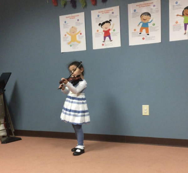 One of my four year-old students from teaching at Robert M. Sides. We had a casual recital!