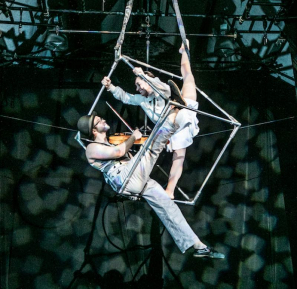 Playing violin inside an aerial cube with aerialist Megan Mallouk in the circus-theatre production ALL THE TIME IN THE WORLD.