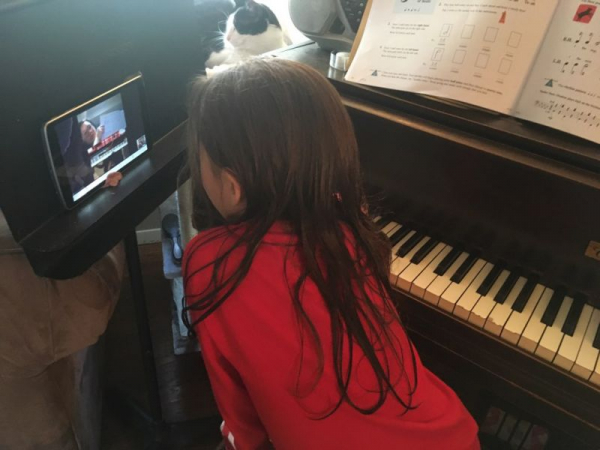 One of my students paying attention while I explain a new musical concept.