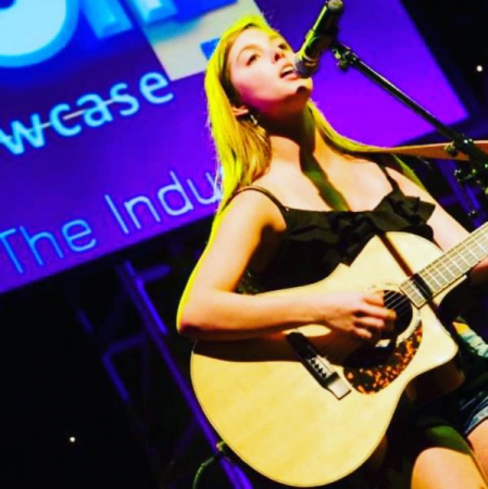 Songwriting, vocal and piano student onstage at a show in Hollywood, CA that I arranged for her to perform at.