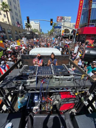 DJing on a truck during the ABLM protest during Pride