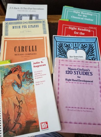 Classical guitar method books and song books.