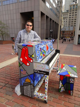 Eddie Bruckner with his painted piano at Boston City Hall Plaza for the Celebrity Series of Boston's Public Art Exhibit.