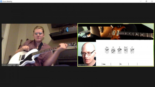 Jason and I sorting out barre chords in a song.