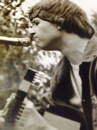 Performing in Shmit's St. Louis Folk Festival on a Yamaha 12-string acoustic, 1980.