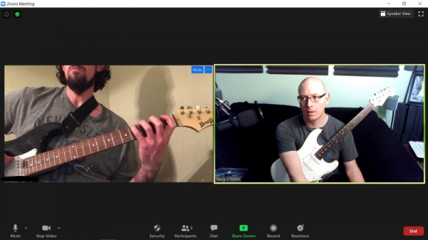 Jason about to demonstrate to me how a power chord is setup
