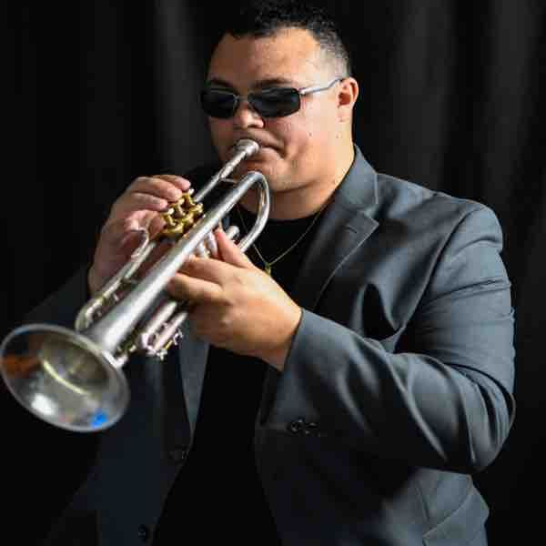Photo of me playing trumpet.