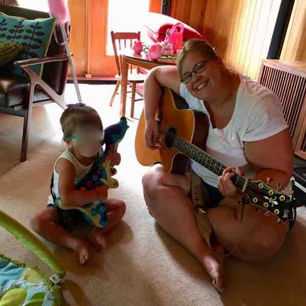 Playing guitar with the kid that I nanny for!