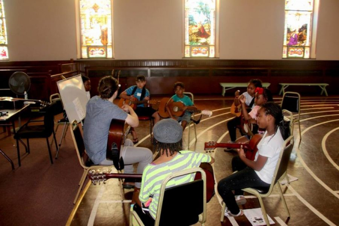 Teaching a guitar class at the Rock to the Future Summer Music Camp in Philadelphia
