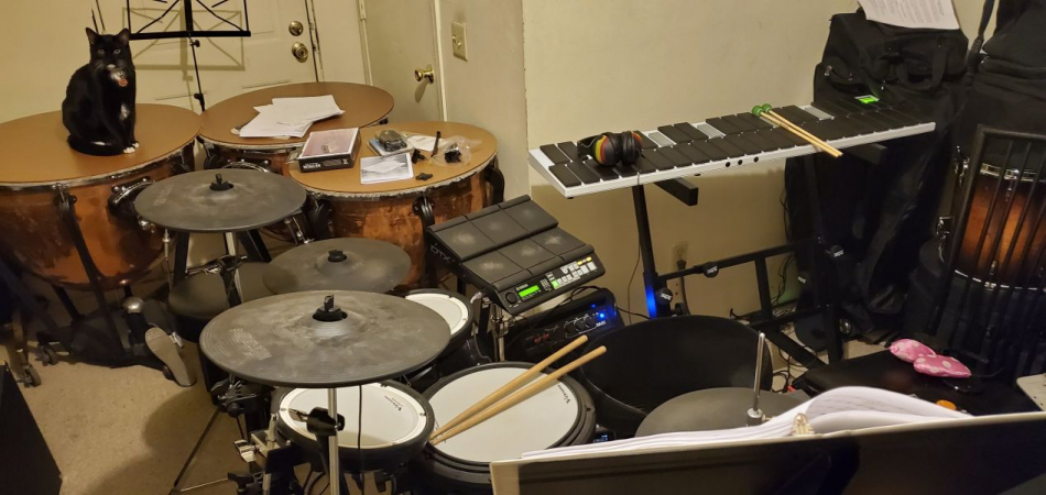 Here's Sean's set-up for the musical Lend Me A Tenor. Oswald, ever the vigilant guard cat, is always watching over Sean's stuff.