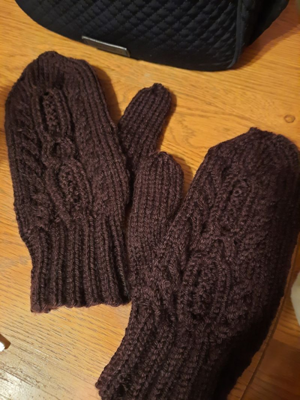Knitted mittens: 1 skein DK weight yarn, 100% acrylic NOT recommended. Intermediate level.
