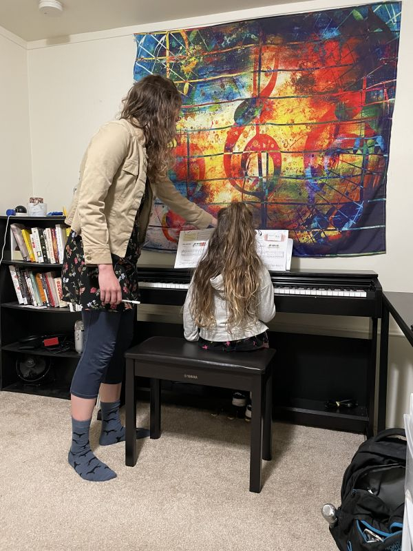 What a lesson looks like in my studio. My digital piano has mallet-graded keys (the best!). Acoustic pianos available upon request.