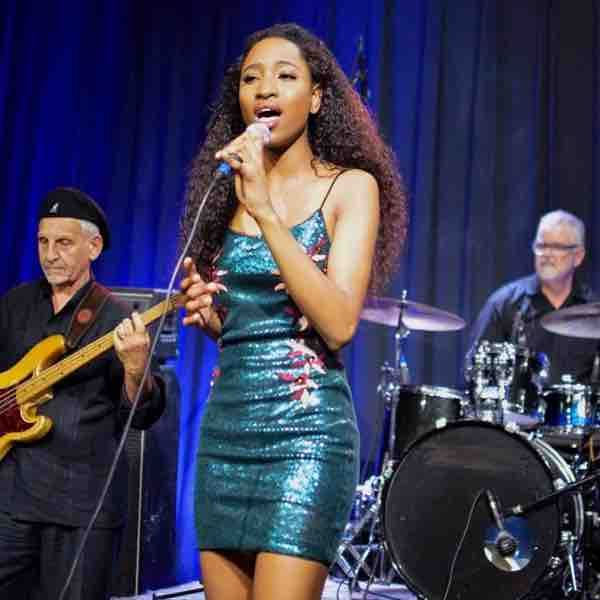 Tony Kessler (Mr.Tony) playing bass for his former singer- songwriter student Chineyre