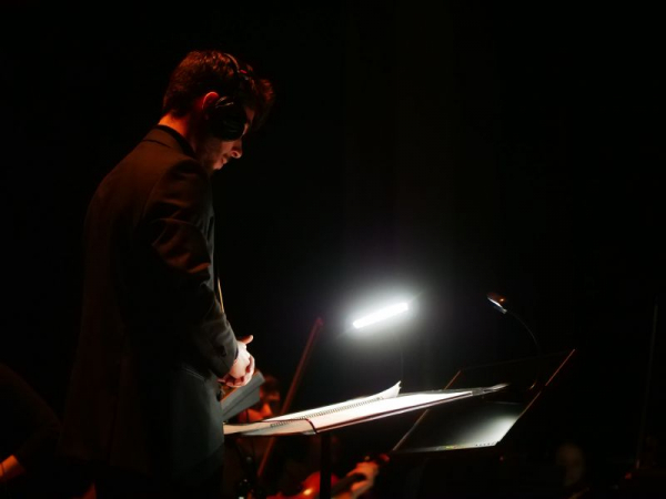 Conducting my score for Elas live to picture