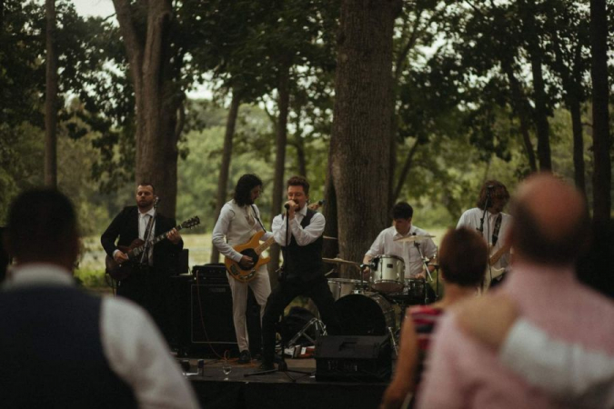 Playing at a wedding with my cover band The X Generation.