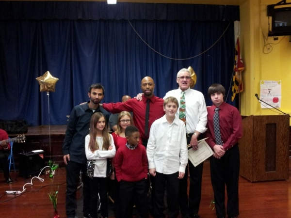 A photo with some of my students after our winter recital. Great job everyone!