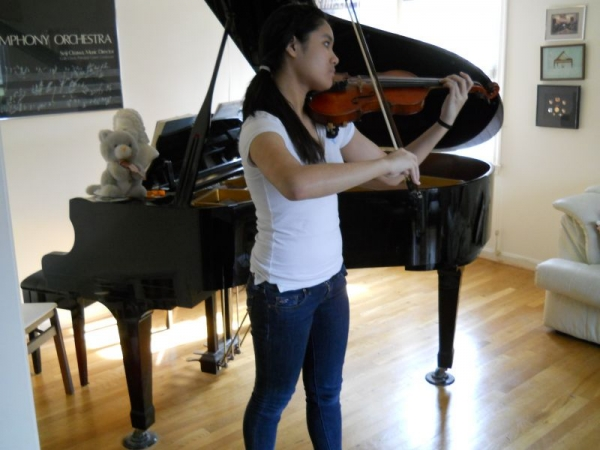 A student practicing for a solo recital