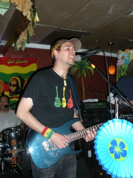 Playing in a local reggae band called Iyah Ites. At S-Lounge at the time.