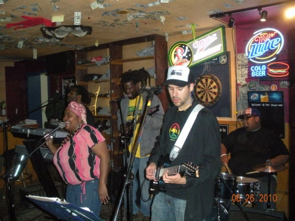 Playing with the reggae band Iyah Ites at the Brown Bear in 2010.