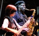 Former student and still friend now 14 Alex Shaw performing with the late Clarence Clemons
