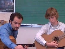 Teaching the a young student basic guitar technique at Clark College.