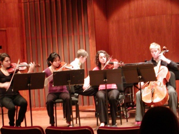 On stage at Lawrence University debuting a new composition. Caitlin loves working with composers to bring new work to life.