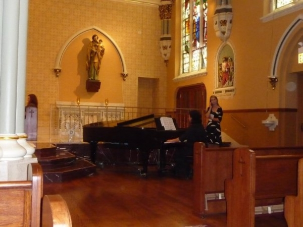 Doing a sound check with the piano before a wedding.