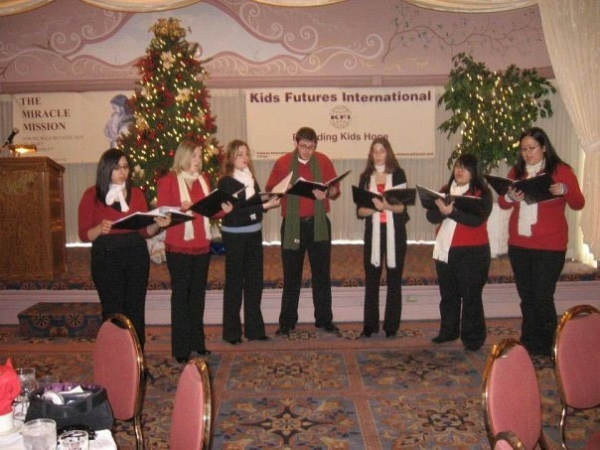 Performing Christmas carols at a fundraiser.