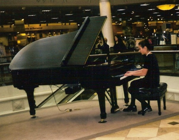 Performing at a recital held in the upper level of Nordstrom in Old Orchard Shopping Center.