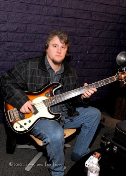 Chris with Wilson Brothers bass, backstage at the King Cat Theater