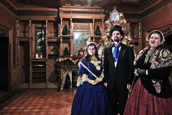 The Mistletoe Singers caroling at the Winchester Mystery House.