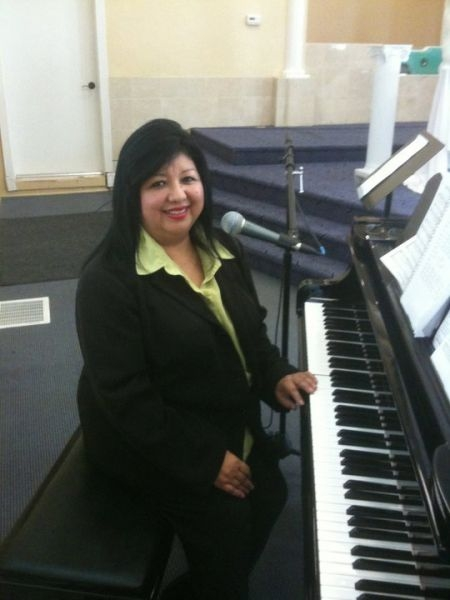 Playing piano and singing for a Quinceniera (a young girl turning 15) ceremony.