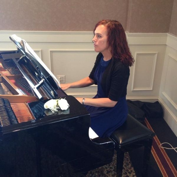 Myself as the pianist at a Wedding and Reception.  I played various styles of music for 2 1/2 hours.