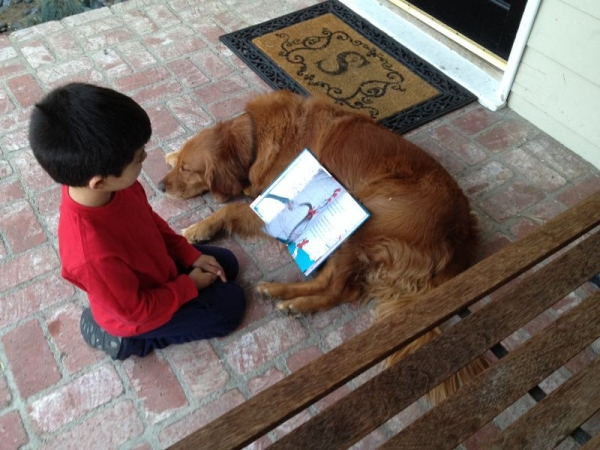 My dog Jude motivating a young reader.....whatever it takes!
