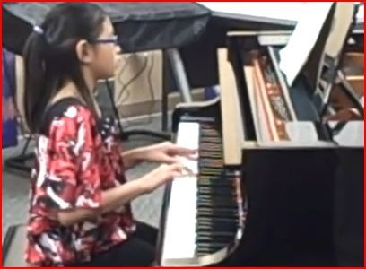 My student playing a recital piece.