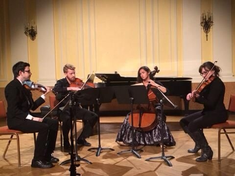 Playing Shostakovich String Quartet No. 7 on a recital at New England Conservatory of Music.