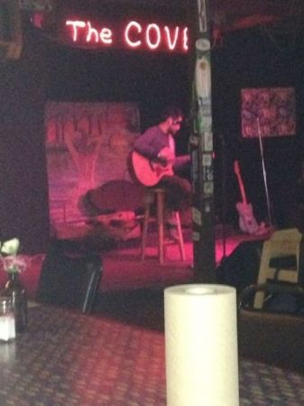 Playing at an open mic at The Cove.