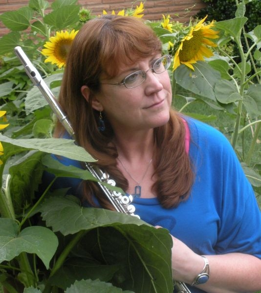 Rogue sunflowers were growing in my backyard from the bird seed I put out for the cardinals.  I couldn't resist getting a picture with them.