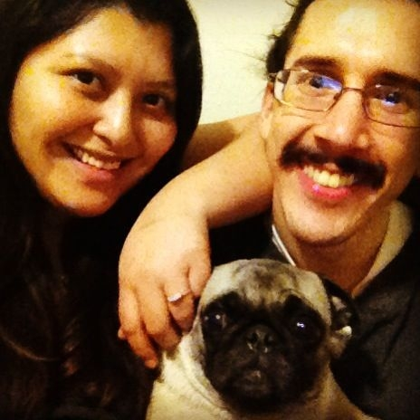 Me with my fiancee and our pug.